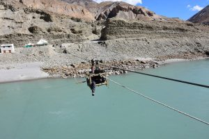 Crossing the river to get to Chilling, Ladakh.
